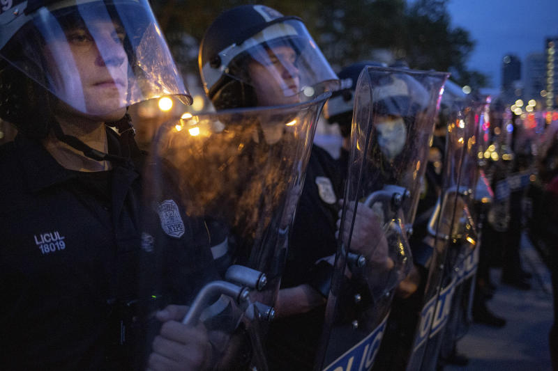 NYPD officers form a line after curfew fell amid protests against police violence in Brooklyn, Wednesday, June 3, 2020. (Amr Alfiky/The New York Times)
