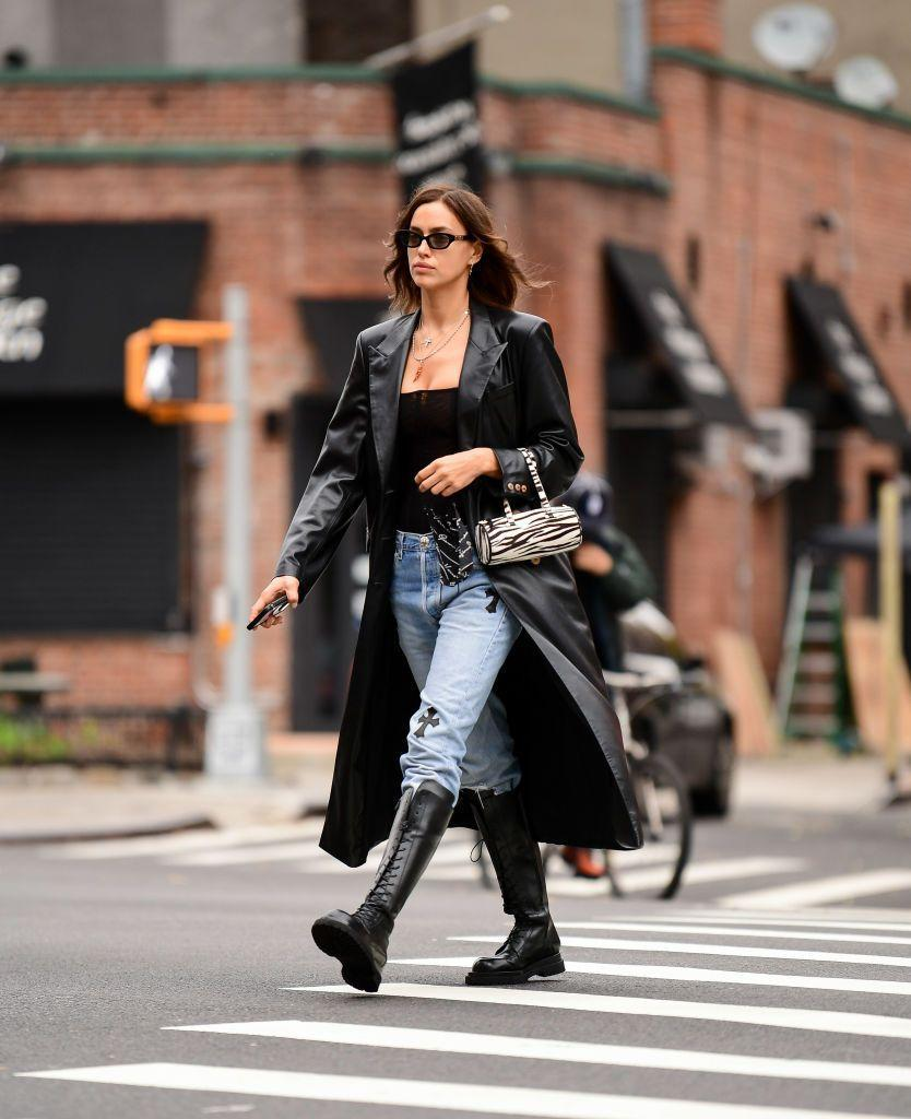 """<p>Rocking her combat boots once more, Shayk paired jeans with a Matrix-style leather coat and cute zebra bag for the school run. </p><p><a class=""""link rapid-noclick-resp"""" href=""""https://go.redirectingat.com?id=127X1599956&url=https%3A%2F%2Fwww.farfetch.com%2Fuk%2Fshopping%2Fwomen%2Fby-far-miranda-zebra-print-shoulder-bag-item-15594903.aspx&sref=https%3A%2F%2Fwww.elle.com%2Fuk%2Ffashion%2Fcelebrity-style%2Fg34359706%2Firina-shayk-style-file%2F"""" rel=""""nofollow noopener"""" target=""""_blank"""" data-ylk=""""slk:SHOP ZEBRA-PRINT BAG NOW"""">SHOP ZEBRA-PRINT BAG NOW</a></p>"""