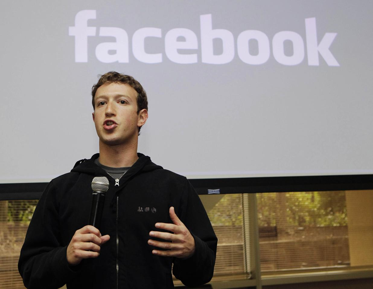 """FILE - In this May, 26, 2010 file photo, Facebook CEO Mark Zuckerberg talks about the social network site's new privacy settings in Palo Alto, Calif. Zuckerberg turns up at business conventions in a hoodie. """"Cocky"""" is the word used to describe him most often, after """"billionaire."""" He was Time's person of the year at 26. So when he takes Facebook public, why would he follow the Wall Street rules? The company is expected to file as early as Wednesday, Feb. 1, 2012 to sell stock on the open market in what will be the most talked-about initial public offering since Google in 2004, maybe since the go-go 1990s. Around the nation, regular investors and IPO watchers are anticipating some kind of twist - perhaps a provision for the 800 million users of Facebook, a company that promotes itself as all about personal connections, to get in on the action. (AP Photo/Marcio Jose Sanchez, File)"""
