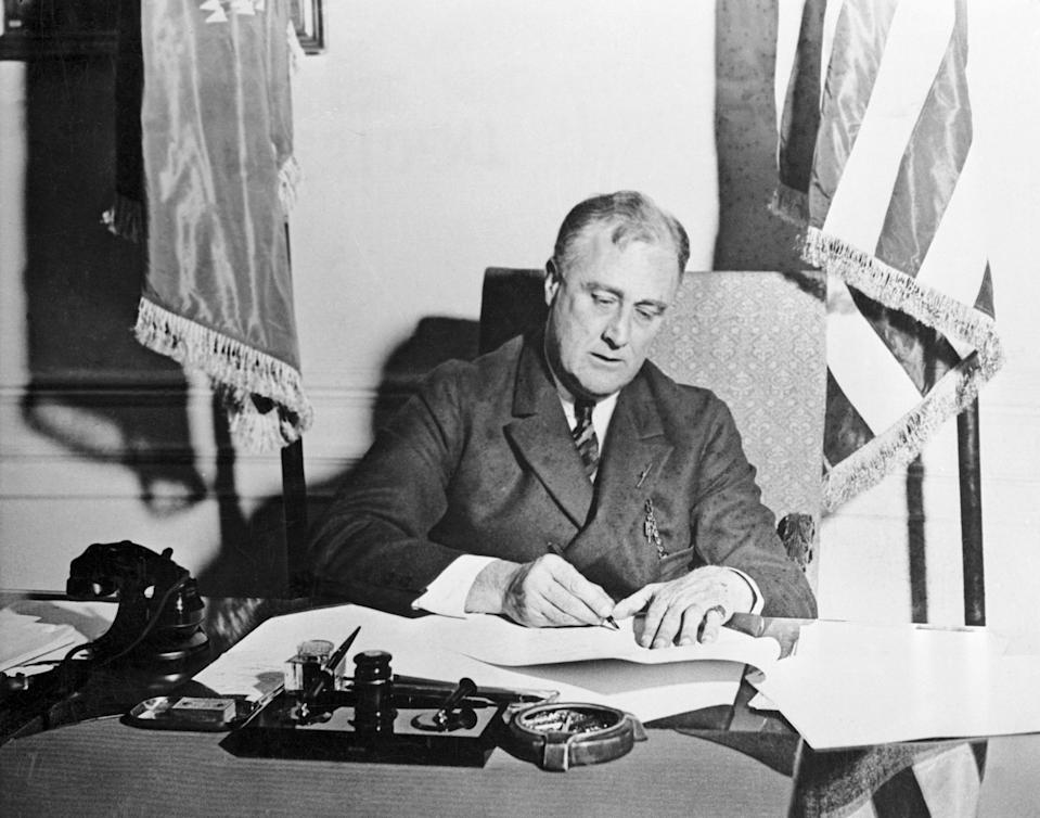 President Franklin D. Roosevelt signs the Emergency Banking Act into law, March 9, 1933. (Photo: AP)