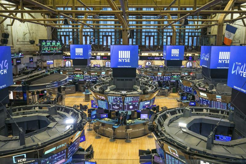 FILE - This photo provided by the New York Stock Exchange shows the unoccupied NYSE trading floor, closed temporarily for the first time in 228 years as a result of coronavirus concerns, Tuesday March 24, 2020. Global stocks and U.S. futures declined Thursday after the U.S. Senate approved a proposed $2.2 trillion virus aid package following a delay over its details and sent the measure to the House of Representatives. (Kearney Ferguson/NYSE via AP, File)