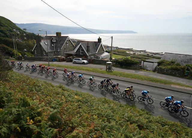 The peloton passes through Barmouth during stage four of the Tour of Britain from Aberaeron to Great Orme, Llandudno.