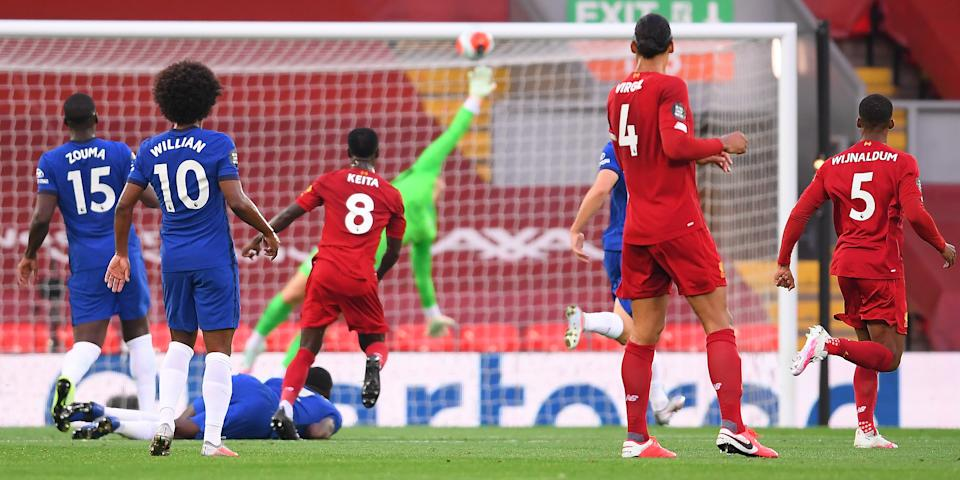Liverpool midfielder Naby Keita (jersey No. 8) scores the opening goal during the English Premier League football match between Liverpool and Chelsea at Anfield. (PHOTO: Laurence Griffiths/POOL/AFP via Getty Images)