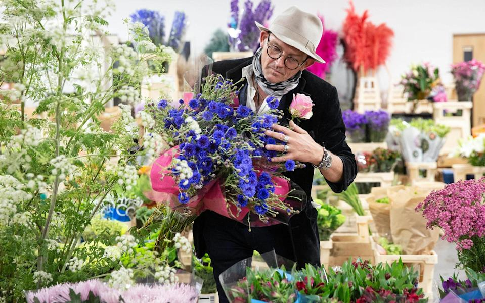 A flower trader at New Covent Garden Market in London ahead of British Flowers Week - PA