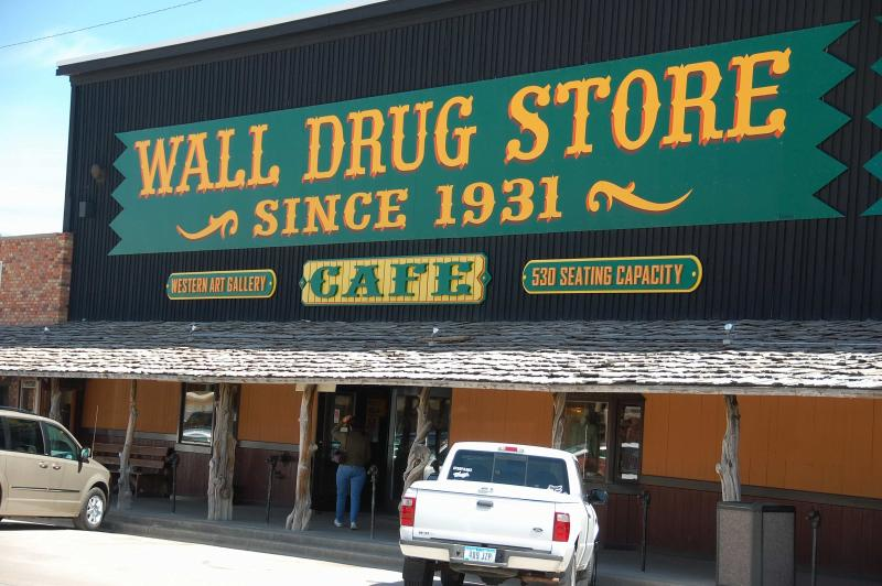 FILE - Ths file photo taken on May 6, 2009 shows the exterior of Wall Drug in Wall, S.D. Wall Drug is a sprawling attraction in the tiny town of Wall, South Dakota, with a drug store, gift shop, restaurants, a chapel and several other stores. Pharmacist Ted Hustead bought the drugstore in 1931, but business was slow until his wife suggested advertising free ice water to parched travelers. The water is still free to tourists enticed to stop here by signs on Interstate 90 on the cusp of the Black Hills. (AP Photo/Carson Walker, file)