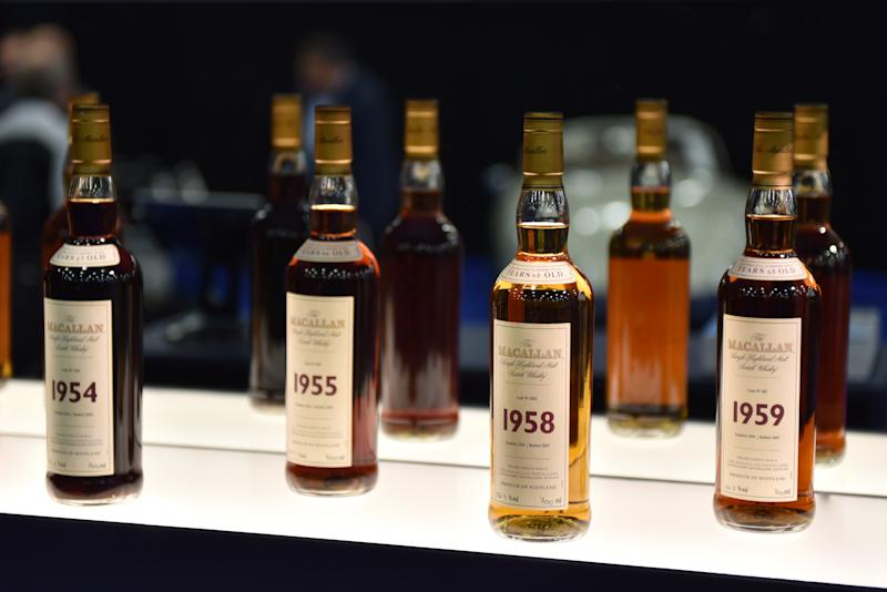 LONDON, ENGLAND - OCTOBER 23: Bottles of various years old Macallan highland single malt whisky are displayed during the RM Sotherb's London, European car collectors event at Olympia London on October 23, 2019 in London, England. RM Sotheby's London, billed as the annual highlight for European car collectors will show Edwardians to modern supercars and offers collectors and attendees the opportunity to experience the very best of European cars. Sotheby's will also present The Ultimate Whisky Collection, the most valuable collection of whisky ever to be sold at auction, both events will culminate in live auctions on 24th October. (Photo by John Keeble/Getty Images)