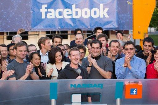 In this image released by Facebook, founder Mark Zuckerberg (C) speaks from the Facebook Menlo Park, California, headquarters as he remotely rang the bell to open the Nasdaq on May 18. Word of Facebook Camera came in the aftermath of an initial public offering of stock that made insiders and investors rich but left small buyers of shares feeling abused
