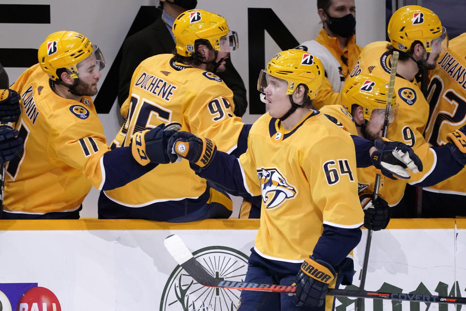 Nashville Predators center Mikael Granlund (64) is congratulated after scoring a goal against the Chicago Blackhawks in the third period of an NHL hockey game Tuesday, Jan. 26, 2021, in Nashville, Tenn. (AP Photo/Mark Humphrey)