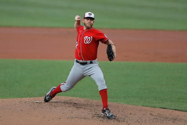 Strasburg gets feel for pitching on the road in a pandemic