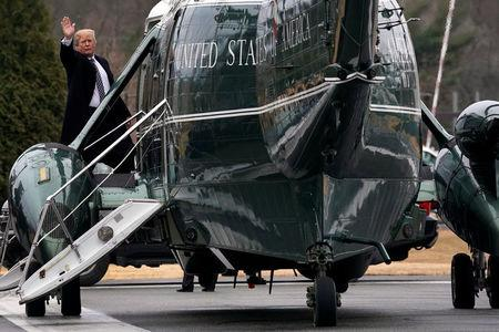 U.S. President Donald Trump waves from the steps of Marine One helicopter upon his departure after his annual physical exam at Walter Reed National Military Medical Center in Bethesda,  Maryland, U.S., January 12, 2018. REUTERS/Yuri Gripas