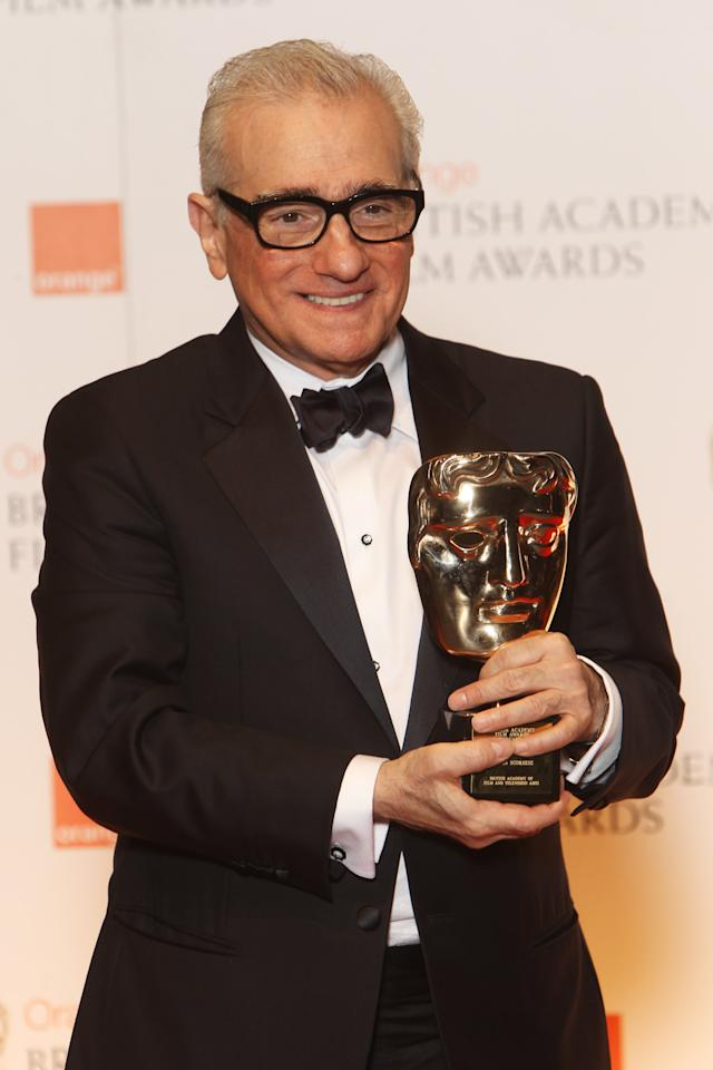 LONDON, ENGLAND - FEBRUARY 12:  (UK TABLOID NEWSPAPERS OUT) Martin Scorsese poses with his Fellowship Award in the press room at The Orange British Academy Film Awards 2012 at The Royal Opera House on February 12, 2012 in London, England.  (Photo by Dave Hogan/Getty Images)