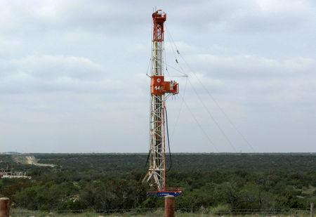 FILE PHOTO: A rig contracted by Apache Corp drills a horizontal well in a search for oil and natural gas in the Permian Basin in West Texas