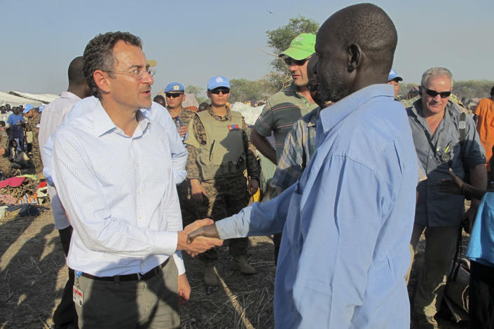 """In this photo taken Tuesday, Dec. 24, 2013 and released by the United Nations Mission in South Sudan (UNMISS) on Wednesday, Dec. 25, 2013, the U.N.'s top humanitarian official in the country Toby Lanzer, left, makes a visit to assess the humanitarian situation at the U.N. compound where many displaced have sought shelter in Bentiu, in oil-rich Unity state, in South Sudan. In New York, the U.N. Security Council voted unanimously Tuesday to beef up its peacekeeping force in South Sudan and condemned targeted violence against civilians and ethnic communities and called for """"an immediate cessation of hostilities and the immediate opening of a dialogue."""" (AP Photo/UNMISS, Anna Adhikari)"""