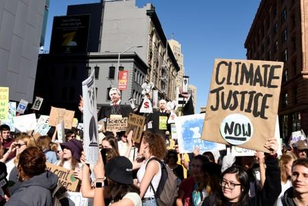 FILE PHOTO: Young people protest outside of the San Francisco Federal Building during a Climate Strike march in San Francisco