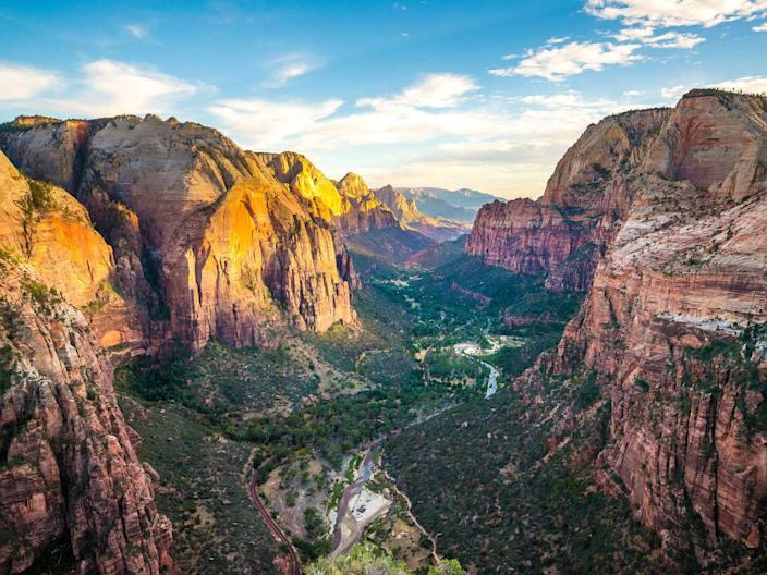 """<p><a href=""""https://www.nps.gov/zion/index.htm"""" rel=""""nofollow noopener"""" target=""""_blank"""" data-ylk=""""slk:Zion National Park"""" class=""""link rapid-noclick-resp"""">Zion National Park</a> is on the top of most road-trip itineraries. It boasts over 146,000 acres of terrain which has easy trails to difficult ones. While it's all adventurous, the main attraction is the Zion Canyon, which is 15 miles long and a half mile deep. Other notable spots are commonly referred to as """"The Subway"""" and """"The Narrows.""""</p>"""