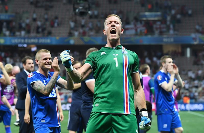 Goalkeeper Hannes Thor Halldorsson of Iceland celebrates the 1-2 victory after the UEFA EURO 2016 Round of 16 soccer match between England and Iceland at Stade de Nice in Nice, France, 27 June 2016. Photo: Federico Gambarini/dpa (RESTRICTIONS APPLY: For editorial news reporting purposes only. Not used for commercial or marketing purposes without prior written approval of UEFA. Images must appear as still images and must not emulate match action video footage. Photographs published in online publications (whether via the Internet or otherwise) shall have an interval of at least 20 seconds between the posting.) | usage worldwide (Photo by Federico Gambarini/picture alliance via Getty Images)