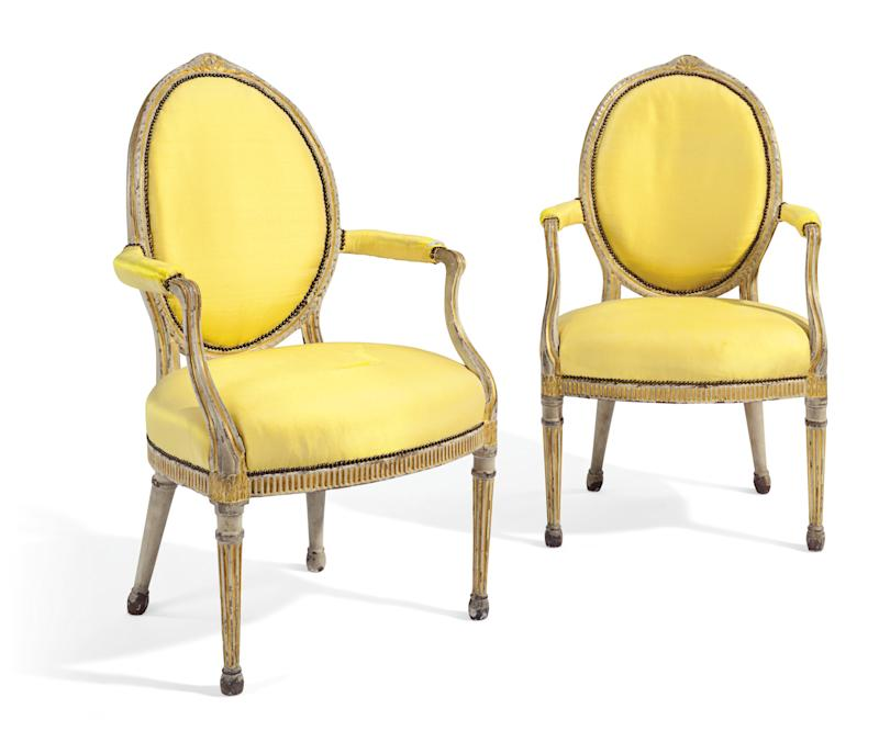 A pair of George III gray-painted and parcel-gilt armchairs, estimated at S3,000–$5,000 in the New York sale.