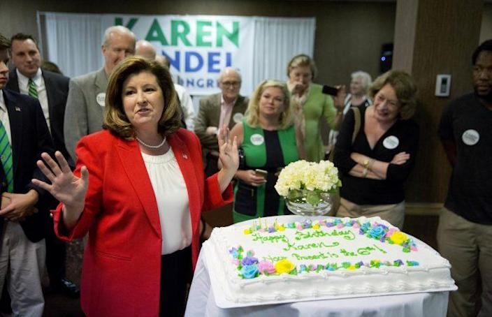 Republican candidate for Georgia's Sixth Congressional seat Karen Handel, left, is presented with a cake as her birthday is celebrated at an election night watch party in Roswell, Ga., Tuesday, April 18, 2017. (Photo: David Goldman/AP)