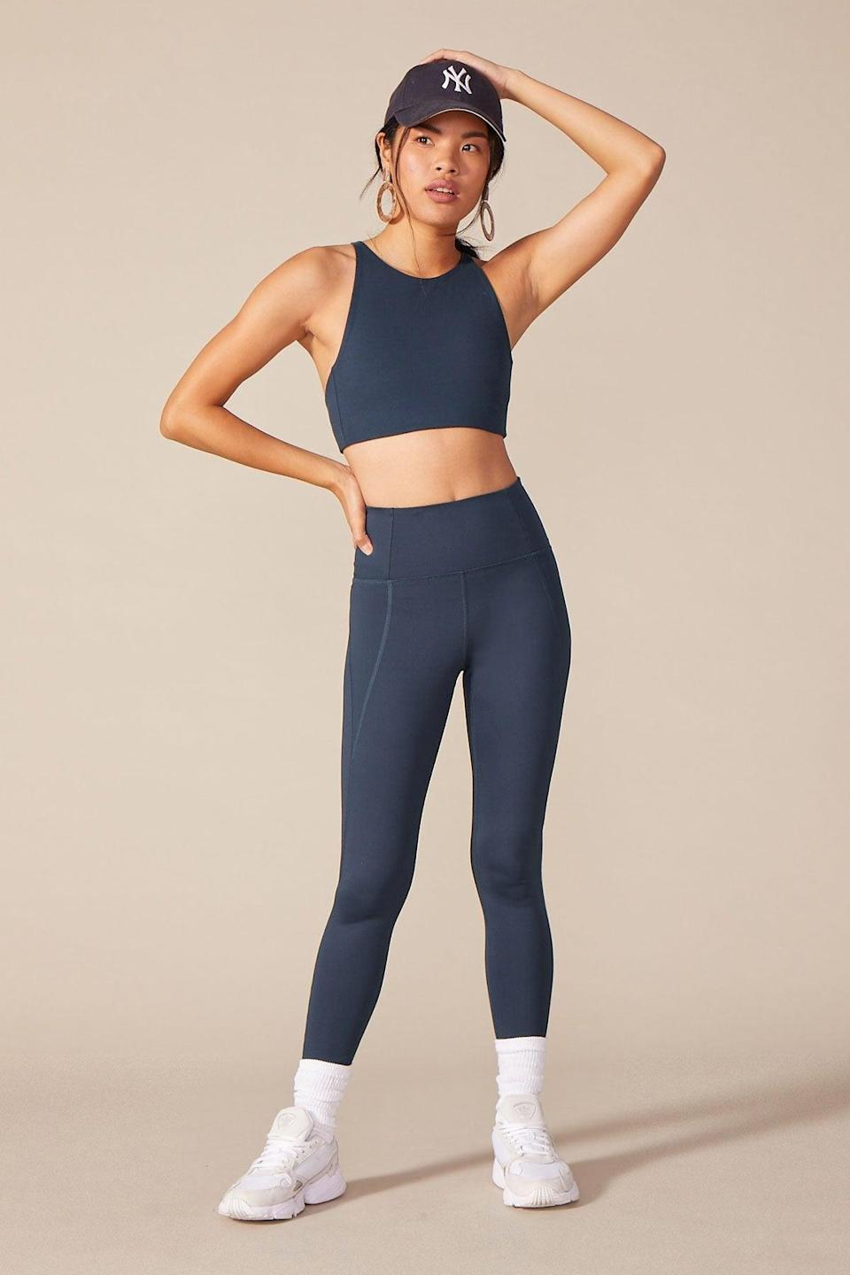 """<h3><h2>Girlfriend Collective Midnight Compressive High-Rise Legging</h2></h3><br><strong><em>Overall Score: 4.0</em></strong><em><br></em><br><strong>Stretch: 4.0</strong><br>I don't mean to brag, but I was able to test out a set from Girlfriend Collective while taking a hike in Hawaii (I know, right?!). The pair I tried out definitely has some great stretch to them, and they're also soft and comfy AF.<br><br><strong>Sweat wicking: 4.3</strong><br>The temps in Hawaii were around 80 degrees, and let me tell you — I'm the kind of person who can <em>easily</em> work up a sweat. I completed the hike without feeling super uncomfortable or drenched in my own sweat, so I'd give it a thumbs up.<br><br><em>— Lizzy</em><br><br><strong>Girlfriend Collective</strong> Midnight Compressive High-Rise Legging, $, available at <a href=""""https://go.skimresources.com/?id=30283X879131&url=https%3A%2F%2Fwww.girlfriend.com%2Fproducts%2Fmidnight-compressive-high-rise-legging%3Fvariant%3D7597773586495"""" rel=""""nofollow noopener"""" target=""""_blank"""" data-ylk=""""slk:Girlfriend Collective"""" class=""""link rapid-noclick-resp"""">Girlfriend Collective</a>"""