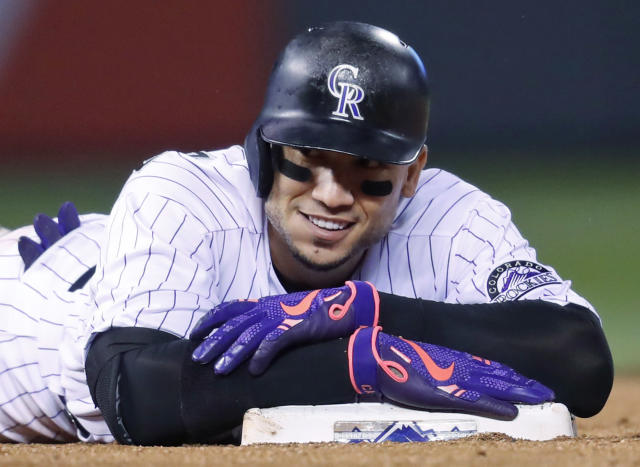Carlos Gonzalez on Friday agreed to return to the Colorado Rockies on a one-year, $8 million contract. (AP)
