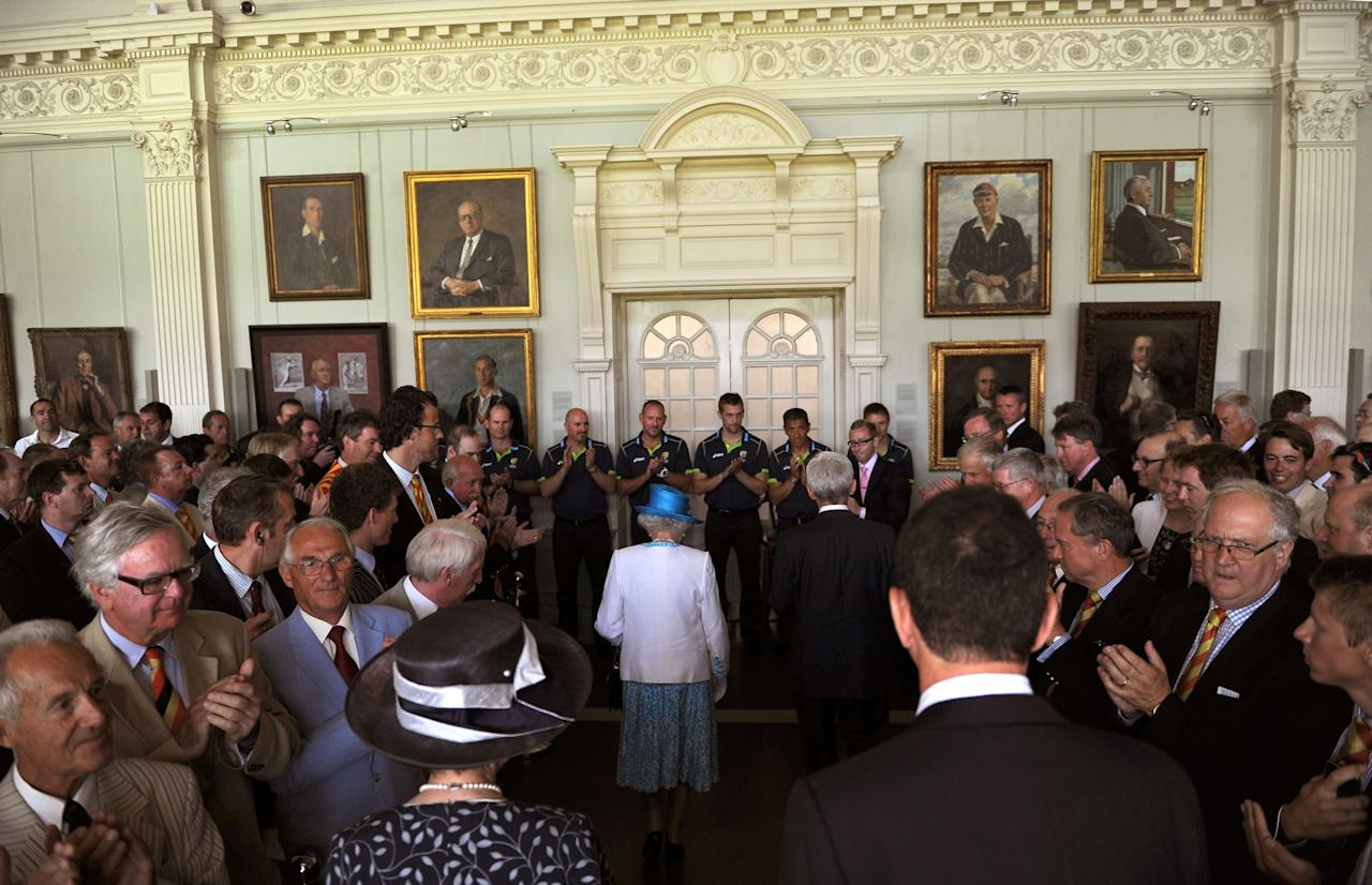 Queen Elizabeth II receives applause from MCC members inside the Long Room of the Pavilion at Lord's Cricket Ground, London, ahead of the first day of the second test between England and Australia.