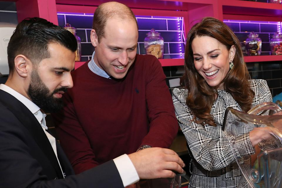 Britain's Prince William, Duke of Cambridge and Britain's Catherine, Duchess of Cambridge help make glasses of Kulfi lassi during a visit to the British Asian 'MyLahores' flagship restaurant in Bradford on January 15, 2020, to learn about some of the community work undertaken by the restaurant. (Photo by Chris Jackson / POOL / AFP) (Photo by CHRIS JACKSON/POOL/AFP via Getty Images)