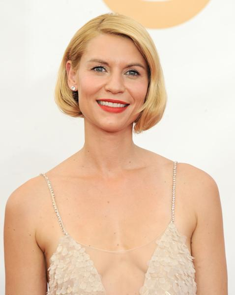 Claire Danes, wearing Atelier Versace, arrives at the 65th Primetime Emmy Awards at Nokia Theatre on Sunday Sept. 22, 2013, in Los Angeles. (Photo by Jordan Strauss/Invision/AP)