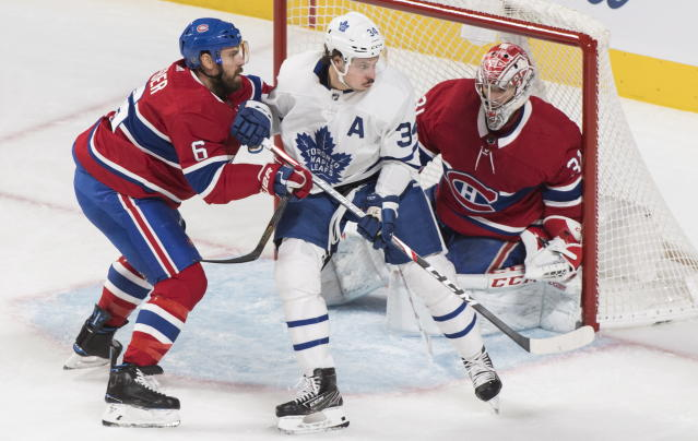 Toronto Maple Leafs' Auston Matthews (34) moves in on Montreal Canadiens goaltender Carey Price as Canadiens captain Shea Weber defends during the first period of an NHL hockey game, in Montreal, Saturday, Oct. 26, 2019. (Graham Hughes/The Canadian Press via AP)