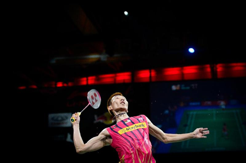 Malaysia's Lee Chong Wei competes against Denmark's Axelsen during the single semi final match at the 2014 BWF Badminton World championships held at the Ballerup Super Arena in Copenhagen on August 30, 2014