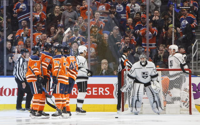 Los Angeles Kings goalie Jonathan Quick (32) watches as Edmonton Oilers celebrate a goal during the first period of an NHL hockey game Saturday, March 24, 2018, in Edmonton, Alberta. (Jason Franson/The Canadian Press via AP)