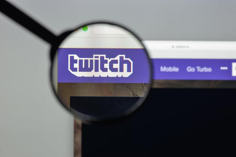 A magnifying glass is overtop of the twitch logo on a browser
