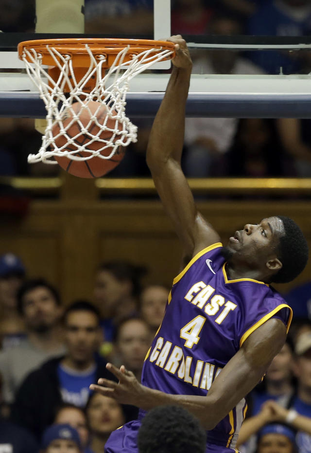 East Carolina's Prince Williams (4) dunks against Duke during the first half of an NCAA college basketball game in Durham, N.C., Tuesday, Nov. 19, 2013. (AP Photo/Gerry Broome)