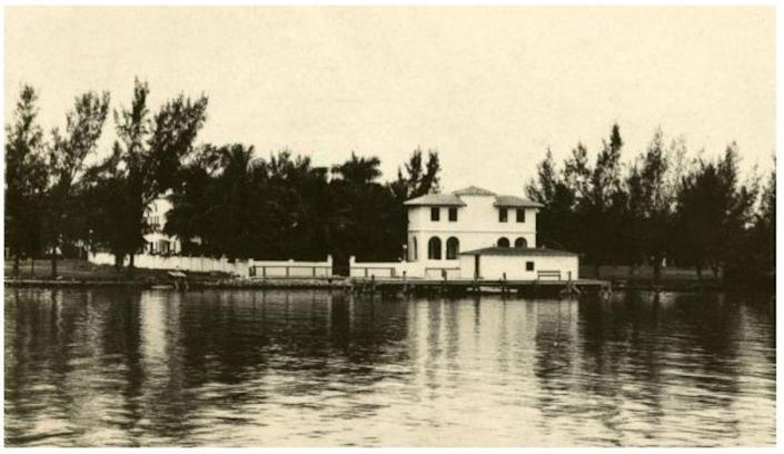 <p><i>Al Capone bought this Miami house (obscured by trees in this photo) in 1928 and died there in 1947. His pool house stands out above the water.</i></p>