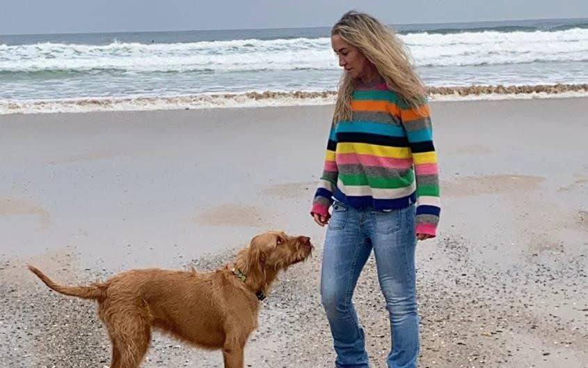 Meg and her dog Ziggy on the beach in her new home in Cornwall