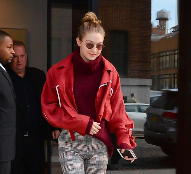 <p>The model was seen for first time since her break up with former One Direction singer Zayn Malik on Thursday morning. Hadid, who dated Malik for two years, wore a cropped red jacket and sunglasses, and smiled sweetly as she headed to work in NYC. (Photo: Backgrid) </p>