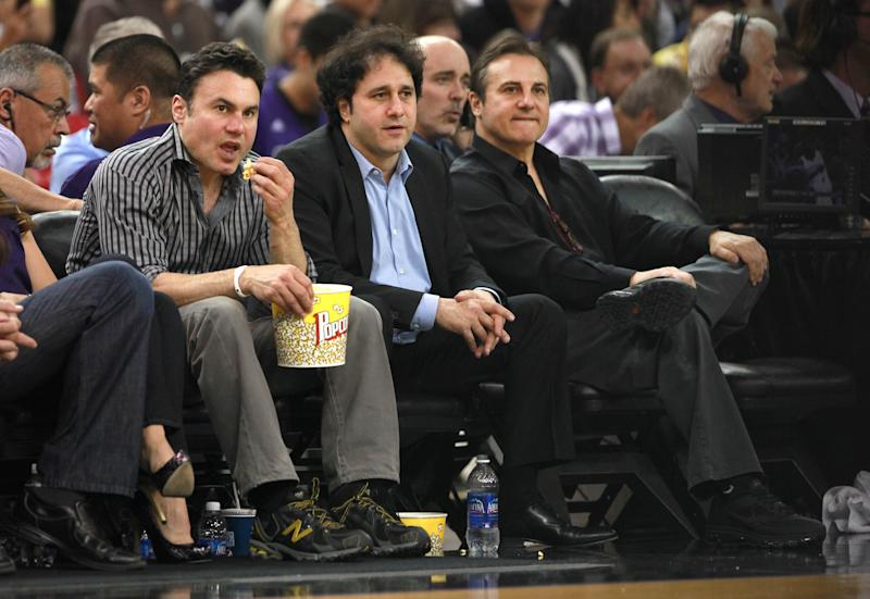 """FILE - In this April 26, 2012 file photo, the Maloof brothers, Phil, left, George, center and Gavin, co-owners of the Sacramento Kings, watch their team against the Los Angeles Lakers during an NBA basketball game in Sacramento, Calif. The Maloof family is asking NBA owners to approve the sale of the Kings to a Seattle group, saying there is """"significant distance between us and the Sacramento group."""" (AP Photo/Rich Pedroncelli, File)"""