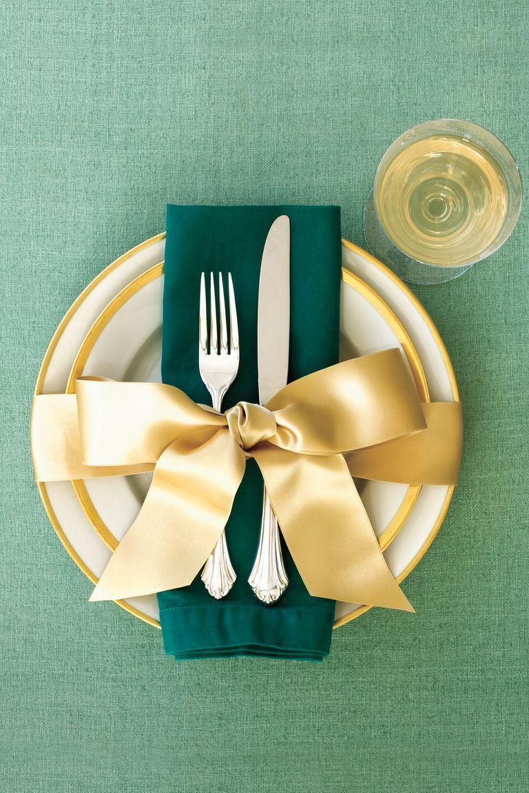 <p>Here's a simple yet stunning way to dress up your dining room for sit-down gatherings. It couldn't be quicker — just wrap each place setting with a length of wide, pretty ribbon. </p>