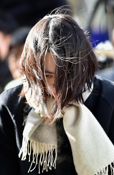Cho Hyun-Ah, the daughter of Korean Air's chief executive, arrives for questioning at the prosecutors' office in Seoul on December 17, 2014 (AFP Photo/Jung Yeon-Je)