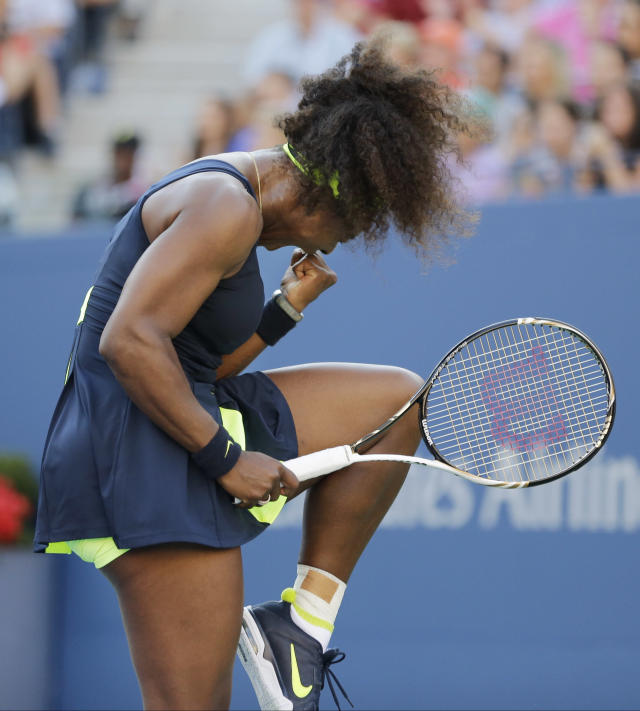 Serena Williams reacts while playing Victoria Azarenka, of Belarus, during the championship match at the 2012 US Open tennis tournament, Sunday, Sept. 9, 2012, in New York. (AP Photo/Mike Groll)