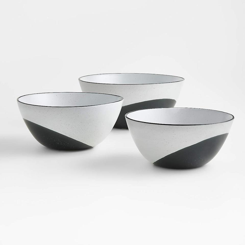 """If you're looking for a set of mixing bowls that are gorgeous enough to also be used as guest-worthy servingware, these make a fine candidate. (Bonus: If you rinse them post-prep and use them for serving, you'll have fewer dishes to wash at the end of the night.) And just because these glazed stoneware bowls are works of art, that doesn't mean they're not practical: Dishwasher-, microwave-, and oven-safe—up to 250 degrees Fahrenheit, perfect for keeping dinner warm—they're also sturdy and hard to chip. $56, Crate and Barrel. <a href=""""https://www.crateandbarrel.com/thero-mixing-bowls-set-of-3/s232805"""" rel=""""nofollow noopener"""" target=""""_blank"""" data-ylk=""""slk:Get it now!"""" class=""""link rapid-noclick-resp"""">Get it now!</a>"""