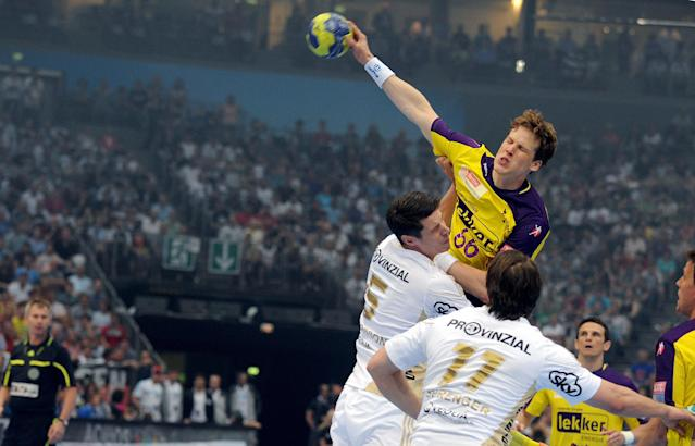 Berlin's Sven-Soeren Christophersen (top) vies against players of Kiel during the Handball Champions League EHF Final Four semi final match Fuechse Berlin vs THW Kiel on May 26, 2012 in Koeln, western Germany. AFP PHOTO JONAS GUETTLER GERMANY OUTJONAS GUETTLER/AFP/GettyImages