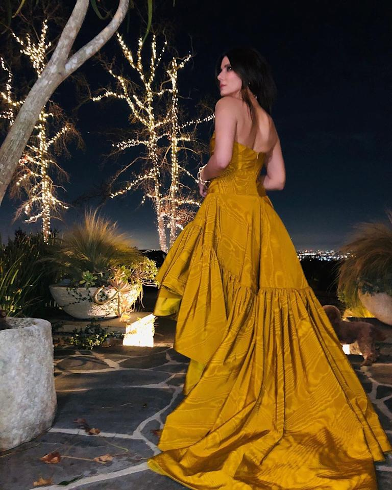 "<p>One trick to getting incredible Instagram photos every time? Date a photographer! Sandra Bullock's <a href=""https://people.com/celebrity/sandra-bullock-dating-los-angeles-photographer-bryan-randall/"">boyfriend</a> of nearly five years snapped this stunning shot of her in a strapless golden gown on the night of the 2020 Golden Globes, where she presented the final award of the night.</p>"
