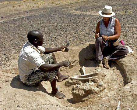 Dr Marta Mirazon Lahr (R) and Justus Edung are pictured at the end of the excavation of the skeleton of a woman found in the sediments of a lagoon 30km west of Lake Turkana, Kenya, at a place called Nataruk, in this undated handout photo obtained by Reuters January 20, 2016. REUTERS/Robert Foley/Cambridge University/Handout via Reuters