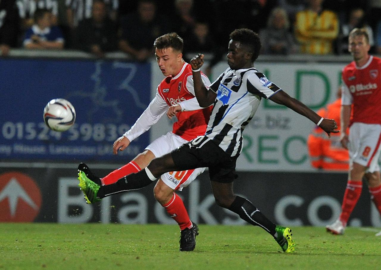 Newcastle United's Gaël Bigirimana and Ryan Williams battle for the ball during the Capital One Cup, Second Round match at the Globe Arena, Morecambe.