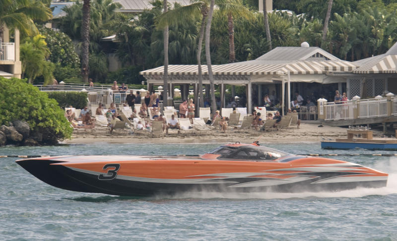 In this photo provided by the Florida Keys News Bureau, CMS, driven by Bob Bulls, of Macks Creek, Mo., and throttled by Randy Scism, of Wentzville, Mo., speeds past spectators during the final of three races Sunday, Nov. 13, 2011, at the Key West World Championship offshore powerboat races in Key West, Fla.  CMS won a world championship in the Superboat Unlimited class, according to race officials. (AP Photo/Florida Keys News Bureau, Andy Newman)