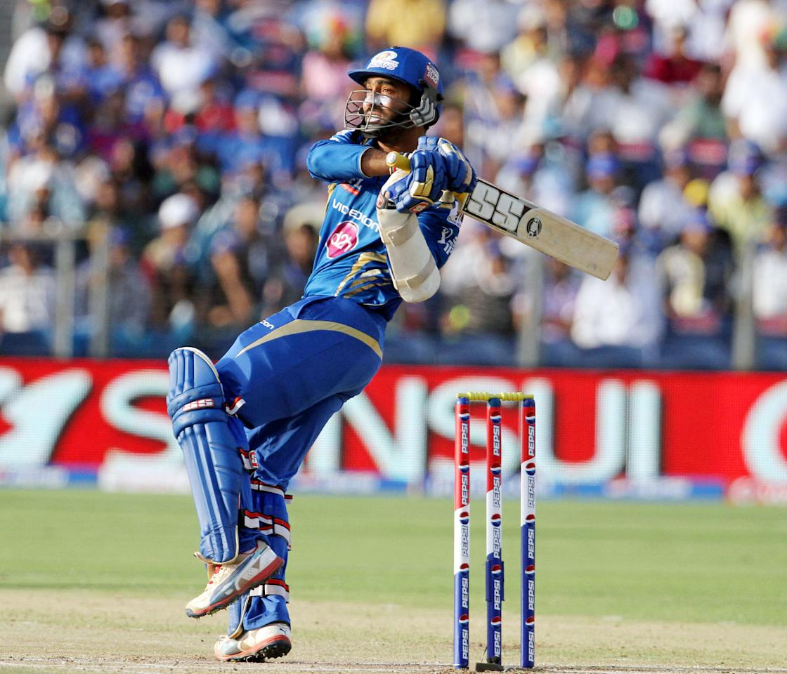 Mumbai Indian player Dinesh Karthik plays a shot during match 58 of the Pepsi Indian Premier League ( IPL) 2013  between The Pune Warriors India and the Mumbai Indians held at the Subrata Roy Sahara Stadium, Pune on the 11th May 2013. (BCCI)