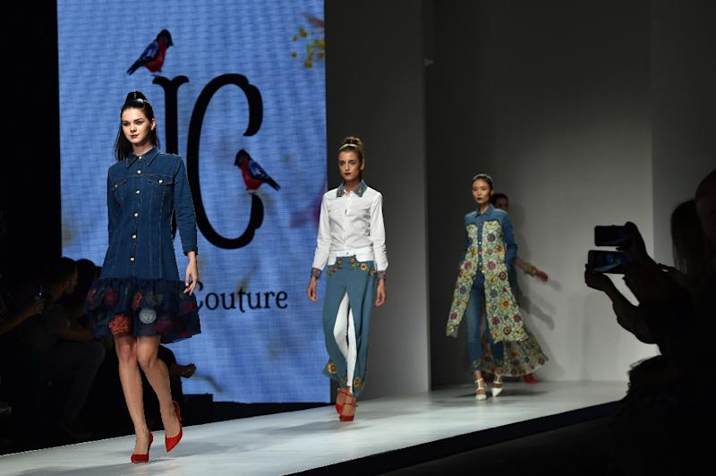 Models present creations by Saudi Arabia's Suzan Farhoud and Leen Al-Shishakly during the Arab Fashion Week on October 8, 2016 in Dubai (AFP Photo/Nezar Balout)
