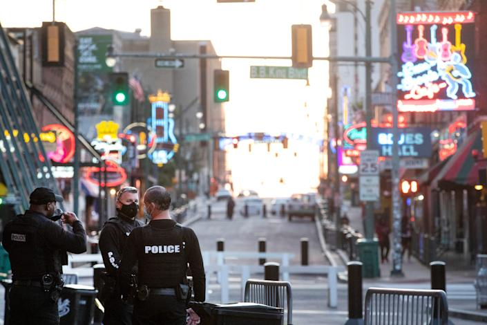 MPD officers wear protective masks as they patrol Beale Street while establishments slowly reopen, part of the city's Phase 1 plan on restarting the economy Friday, May 8, 2020.