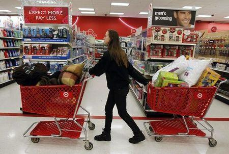 """A woman pulls shopping carts through the aisle of a Target store on the shopping day dubbed """"Black Friday"""" in Torrington, Connecticut November 25, 2011.  REUTERS/Jessica Rinaldi"""