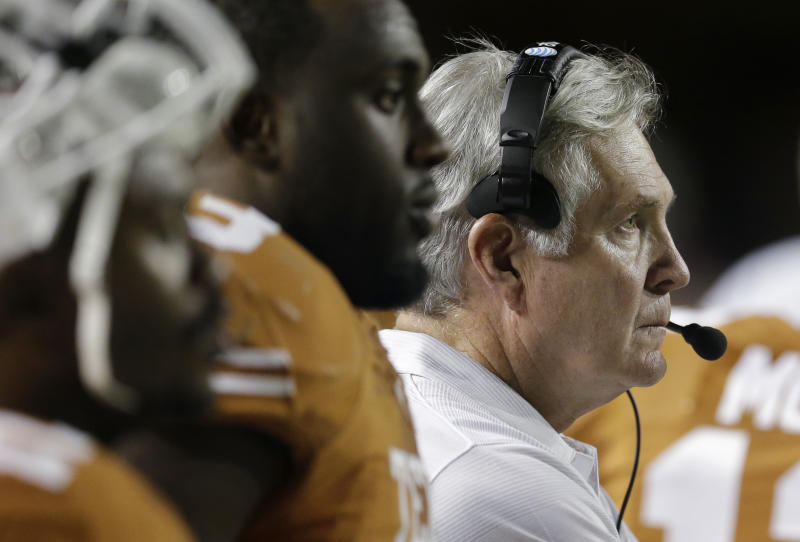 Texas coach Mack Brown, right, watches from the side lines during the second half of an NCAA college football game against Kansas State, Saturday, Sept. 21, 2013, in Austin, Texas. (AP Photo/Eric Gay)